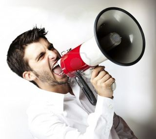 11507629-portrait-of-young-man-shouting-with-megaphone-indoor