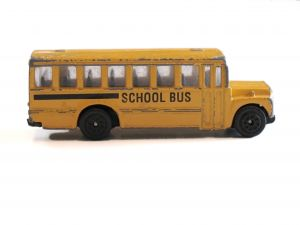 Education school day care yellow school bus toy antique side view
